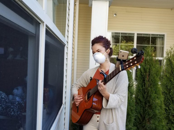 Willamette Valley Hospice Music Therapist sings to patient outside window - VIDEO